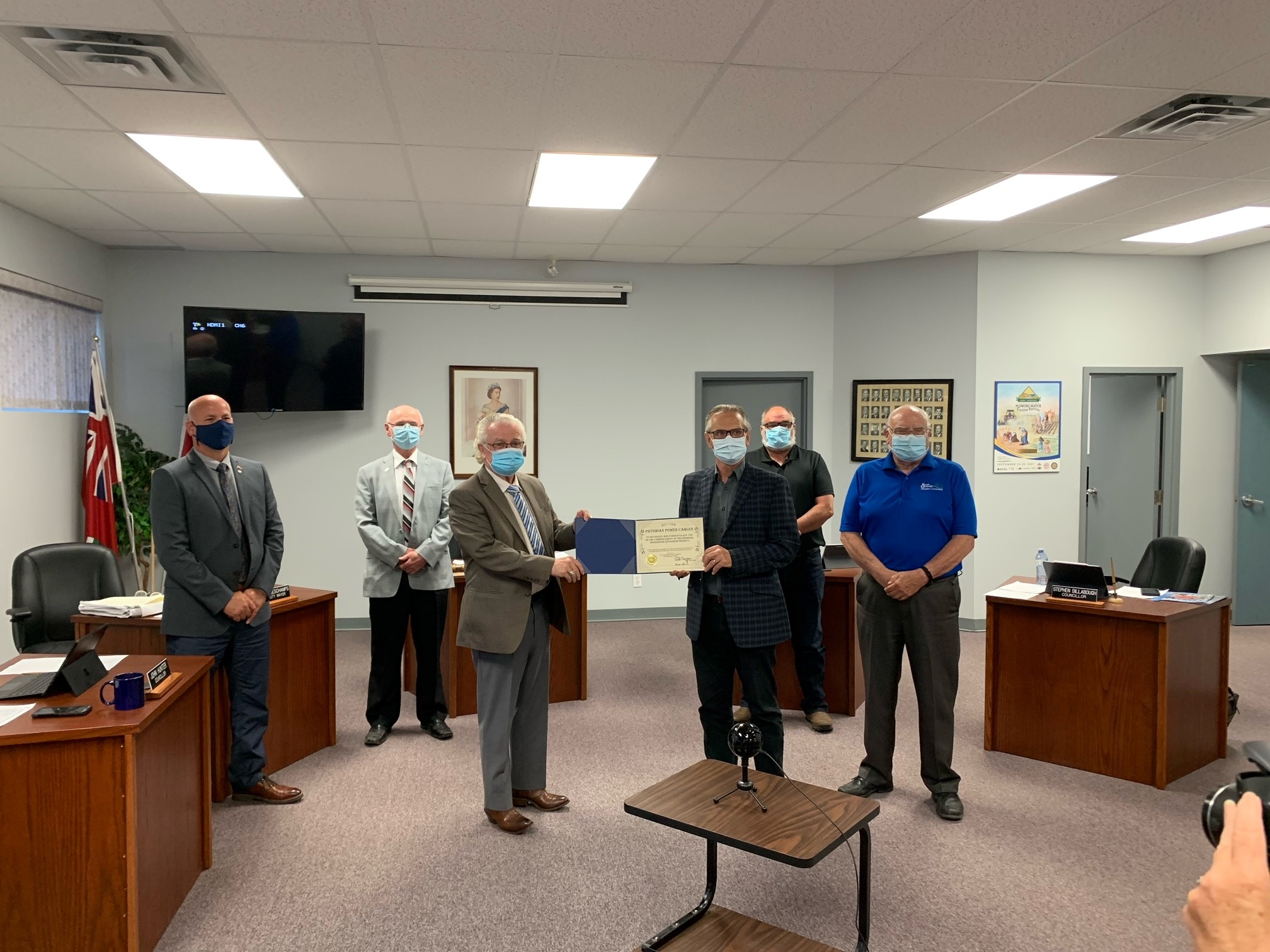 The Mayor and Council make a presentation to Prysmian Group Plant Manager, John Edwards.